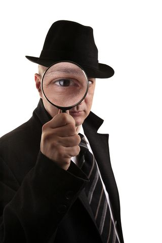 Bigstock-Detective-investigate-with-mag-27016424