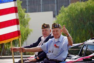 Bigstock-Military-Veterans-Holding-Flag-25716107