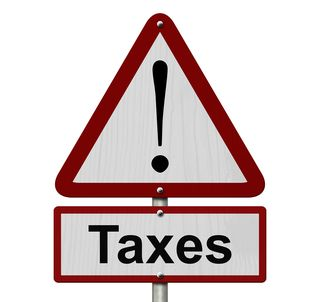 Bigstock-Taxes-Caution-Sign-79630735